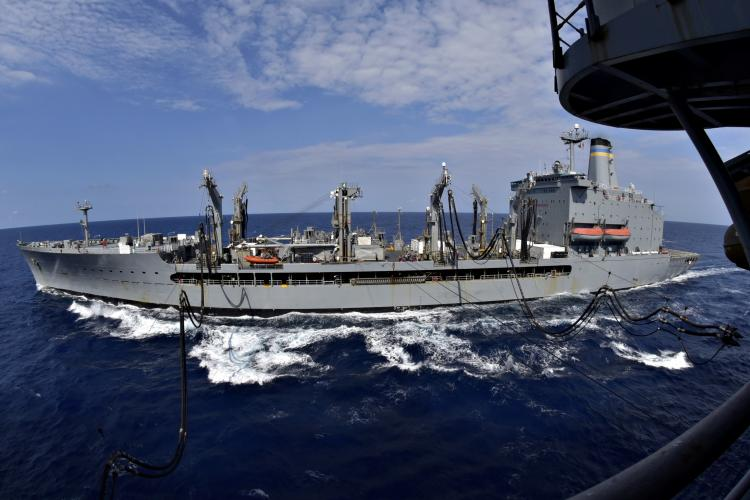 U.S. Navy stock photo of USNS Pecos (T-AO 197) conducting a replenishment-at-sea. (Photo by Mass Communication Specialist 1st Class Daniel Barker)
