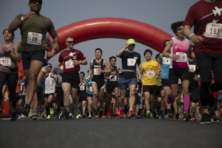 U.S. service members, Marine Corps Air Station (MCAS) Iwakuni residents and local Japanese residents participate in the 52nd MCAS Iwakuni Marathon and Half Marathon at MCAS Iwakuni, Japan, April 7, 2019. The event was held by Marine Corps Community Services Iwakuni in order to strengthen the bond between the local Japanese community and the air station. (U.S. Marine Corps photo by Cpl. Andrew Jones)
