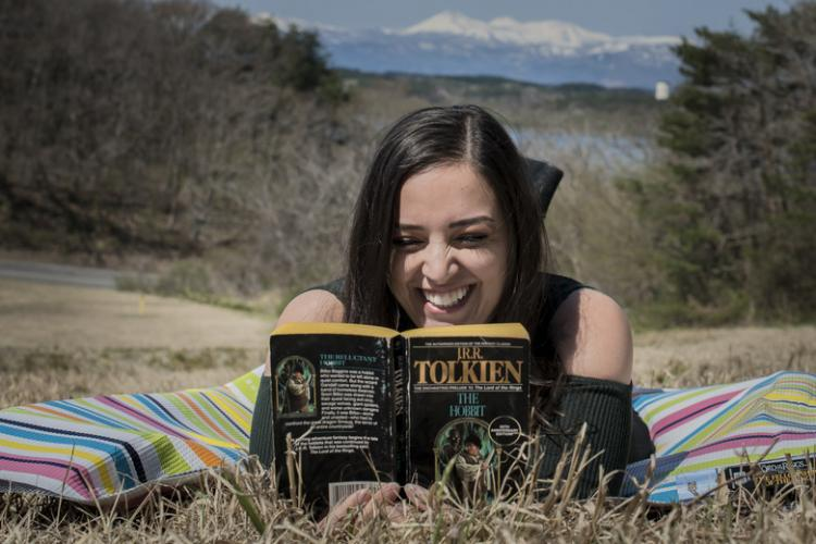 "Tela Royston, a Navy Gateway Inns & Suites program analyst, reads ""The Hobbit"" at Misawa Air Base, Japan, April 29, 2019. Royston believes the move to Misawa provided her family an opportunity to immerse themselves in the Japanese culture and embrace Japan's hiking, camping, photography, beaches, fishing and shopping. (U.S. Air Force photo by Airman 1st Class Xiomara M. Martinez)"