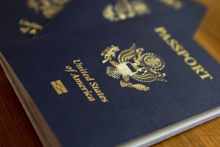 A United States Passport sits on a table prior to being renewed at a United States Embassy Outreach event at Yokota Air Base, Japan, May 22, 2019. The event allowed families of Team Yokota to have access to Passport, Consular Report of Birth Abroad (CRBA), Immigrant Visa, name change, and Social Security services without having to travel to the downtown Tokyo, Japan embassy. (U.S. Air Force photo by Senior Airman Matthew Gilmore)