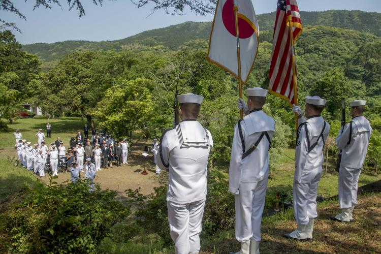 SASEBO, Japan (May 23, 2019) - The Commander, U.S. Fleet Activities Sasebo Color Guard presents the colors during the Soto Dam memorial ceremony May 23, 2019.The annual memorial ceremony is held for the 53 American POWS and 14 Japanese who died building Soto Dam during World War II. Sasebo erected a memorial tower for both American and Japanese dead in 1956. (U.S. Navy photo by Mass Communication Specialist 1st Class David R. Krigbaum)