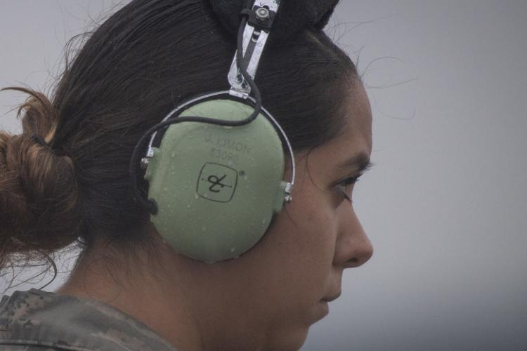 Senior Airman Jacqueline N. Limon, 374th Aircraft Maintenance Squadron aerospace maintenance journeyman, waits for the signal for a C-130J Super Hercules to depart during a black-letter flight at Yokota Air Base, Japan, June 11, 2019. A black-letter flight is a rare accomplishment that few maintenance and air crew members see in their careers. (U.S. Air Force photo by Airman 1st Class Brieana E. Bolfing)