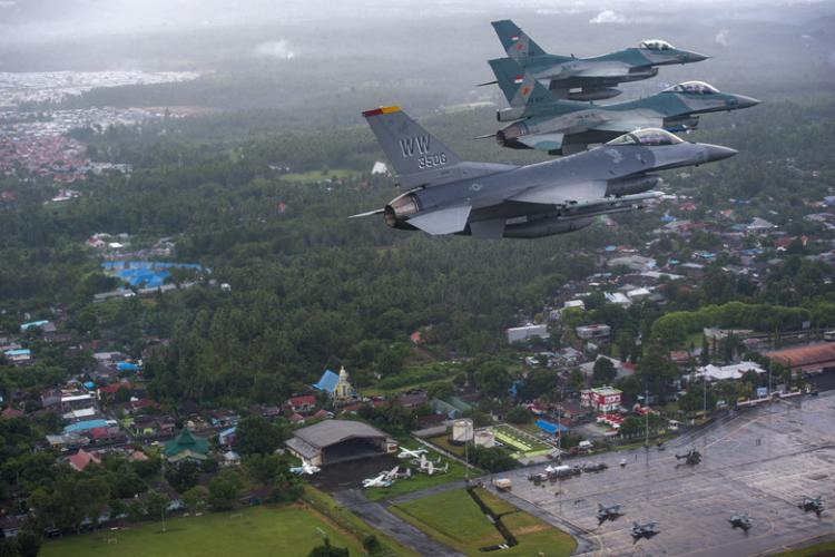 A U.S. Air Force F-16 Fighting Falcon fighter pilot flies alongside two Indonesian air force F-16 Fighting Falcon fighter pilots over the Sam Ratulangi International Airport in Manado, Indonesia, during COPE West 19, June 20, 2019. COPE West is a recurring exercise dating back to 1989, and this year marks the 70th anniversary of diplomatic relations between the U.S. and Indonesia. (U.S. Air Force photo by Staff Sgt. Melanie A. Hutto)