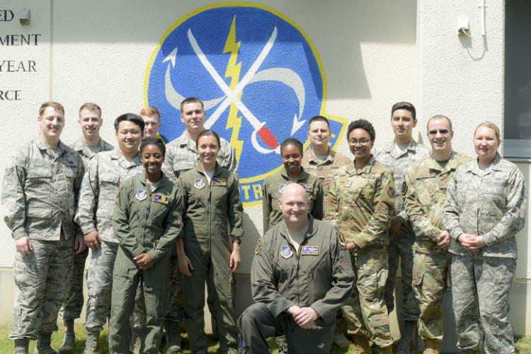 "The U.S. Air Force 610th Air Control Flight pauses for a group photo at Misawa Air Base, Japan, July 31, 2019. The 610th ACF won two Headquarters Air Force-level awards in 2018 including the ""Outstanding Ground-Based Battle Management Command and Control Crew."" Its mission ensured airspace safety for F-16 Fighting Falcon sorties by de-conflicting with multiple aircraft and providing pilots real-time feedback. (U.S. Air Force photo by 1st Lt. Jeremy Garcia)"