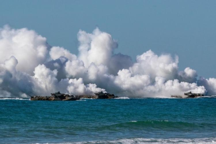 U.S. Marine amphibious assault vehicles give off tactical smoke as they approach Langham Beach, Queensland, Australia, July16, during Exercise Talisman Sabre 2019
