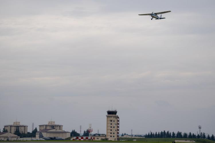 A civilian aircraft flies over Yokota Air Base, Japan, after the Kanto Plains Mid-Air Collision and Avoidance Conference, July 20, 2019. With civilian aircraft granted the rare opportunity to land at Yokota, the event highlighted the partnership between the U.S. Air Force and the host nation of Japan, as the two came together to increase flight safety in the Kanto region. (U.S. Air Force photo by Airman 1st Class Brieana E. Bolfing)