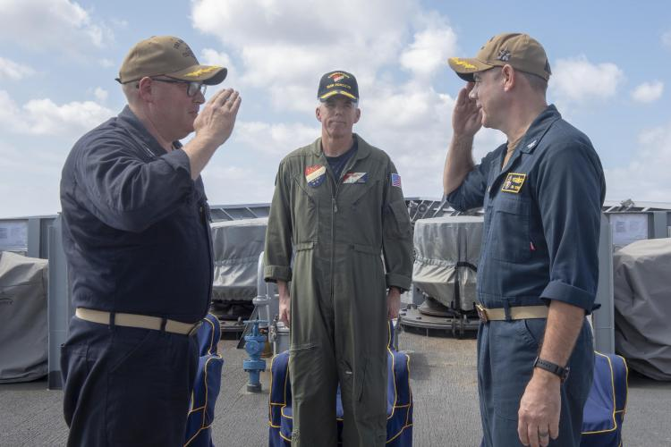 SEA OF JAPAN (Sept. 17, 2019) Rear Adm. Karl Thomas, Commander, Task Force 70 and Carrier Strike Group 5 observes as Capt. Russel Caldwell, left, relieves Capt. James Storm as commanding officer of the Ticonderoga-class guided-missile cruiser USS Antietam (CG 54) during a change of command ceremony. Antietam is forward deployed to the U.S. 7th Fleet area of operations in support of security and stability in the Indo-Pacific region. (Photo by Mass Communication Specialist 2nd Class William McCann)