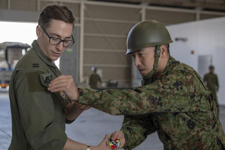 Capt. Jason LaPre, 36th Airlift Squadron C-130J pilot, and Capt. Hideyuki Hotsuki of the Japan Ground Self-Defense Force, trade patches during preparations for the Tomodachi Rescue Exercise at Yokota Air Base, Japan, Feb. 21, 2020. This is the first time Yokota participated alongside JGSDF to conduct a bilateral disaster relief exercise. (U.S. Air Force photo by Airman 1st Class Brieana E. Bolfing)