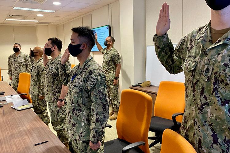 SINGAPORE (March 12, 2021) - Sailors assigned to Commander, Destroyer Squadron Seven (DESRON 7) participate in a Navy-wide stand-down to address extremism in the ranks. DESRON 7 serves as the primary tactical and operational commander of littoral combat ships rotationally deployed to Southeast Asia, builds partnerships through training exercises and military-to-military engagements, and supports Expeditionary and Littoral warfighting commanders. (U.S. Navy photo by Lt. Lauren Chatmas)