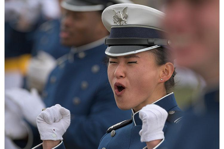 A Class of 2020 cadet celebrates at the graduation ceremony for nearly 1,000 cadets at the U.S. Air Force Academy in Colorado, Springs, Colo., April 18, 2020. (U.S. Air Force photo by Staff Sgt. J.T. Armstrong)