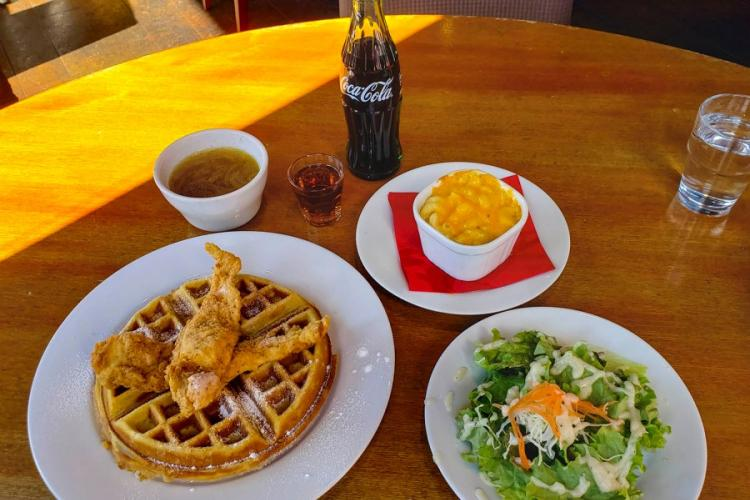 Lunch sets at Soul Food House in Tokyo comes with a main dish (chicken and waffles, in this case), a salad and soup. Add macaroni and cheese for a little extra yen. THERON GODBOLD/STARS AND STRIPES