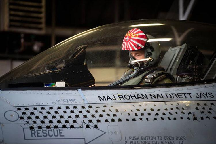 U.S. Air Force Capt. Robert Grochalski, former 35th Fighter Wing PACIFIC WEASEL (PAC WEASEL) mission commander prepares for takeoff after entering the cockpit of an F-16 Fighting Falcon during a routine sortie at Misawa Air Base, Japan, Oct. 5, 2021. Under Grochalski's leadership, the units involved in a PAC WEASEL exercise were empowered to overcome challenging scenarios by sharing innovative techniques and tactics in a joint environment. (U.S Air Force photo by Airman 1st Class Leon Redfern)