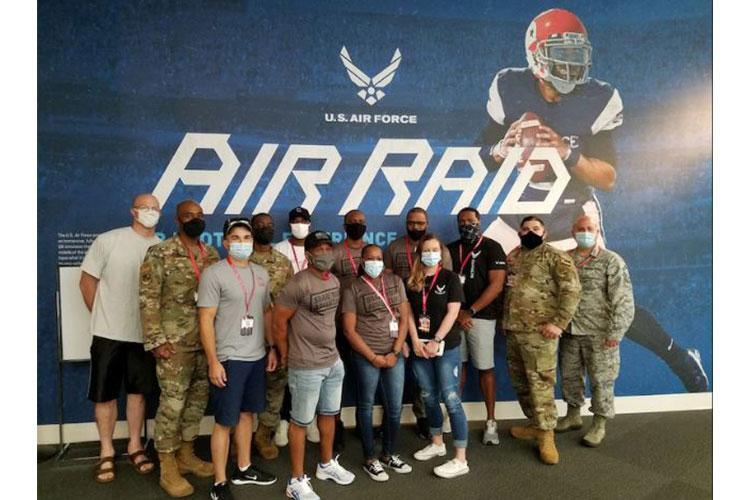 Total Force recruiters pose for a photo at the Chick-Fil-A College Football Hall of Fame, Aug. 28, 2020, in Atlanta. Air Force Recruiting Service recently signed a partnership with the HOF and the Air Force has a major exhibit called the Air Force Air Raid Quarterback Sim Experience. This virtual reality exhibit features technology used to train quarterbacks at both the college and pro levels. The HOF will offer a venue to not only brand the Air Force, but a location for holding events. (Courtesy photo)