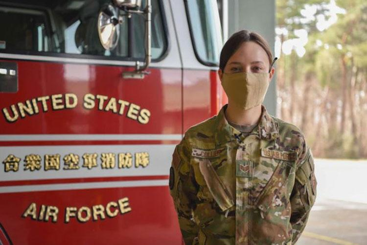 U.S. Air Force Staff Sgt. Journey Collier, a 35th Civil Engineer Squadron firefighter, stands in front of a fire truck at Misawa Air Base, Japan, March 31, 2021. Collier recently won the Air Force Military Firefighter of the Year award and is now representing the Air Force at the Department of Defense level. (U.S. Air Force photo by Airman 1st Class Joao Marcus Costa)