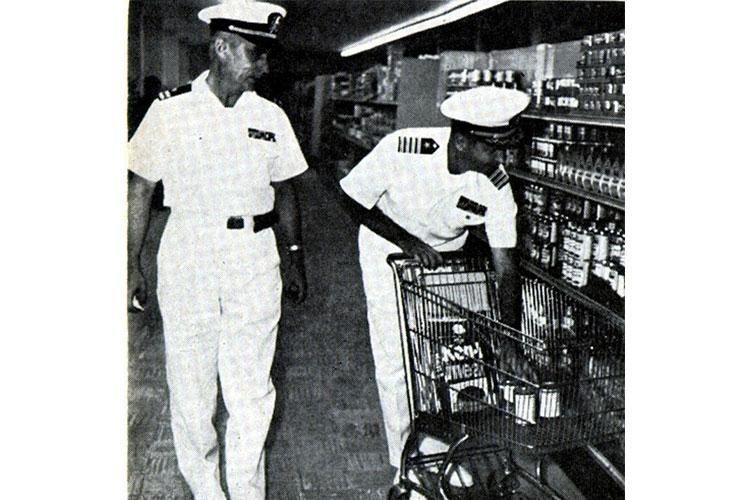 U.S. Naval officers shop in the Saigon Commissary in 1964. (Photo courtesy of Military Market Magazine)
