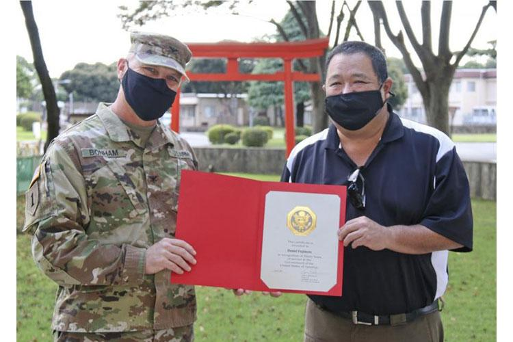 Daniel Fujimoto, Japan Engineer District safety chief, receives his 30 years of service recognition from Col. Gary Bonham, Japan Engineer District commander, during a ceremony at Camp Zama, Japan. Fujimoto is one year into his second tour with the Corps in Japan. (Photo by Honey Nixon)