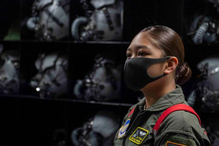 Cadet Chief Master Sgt. Kailea Deleon, Civil Air Patrol Squadron superintendent, learns about the 36th Airlift Squadron's aircraft equipment room during the Pilot for a Day program at Yokota Air Base, Japan, Aug. 7, 2020. The day included a tour of the squadron, a mission brief, aircrew flight equipment familiarization and a C-130J Super Hercules flight. (U.S. Air Force photo by Airman 1st Class Brieana E. Bolfing)