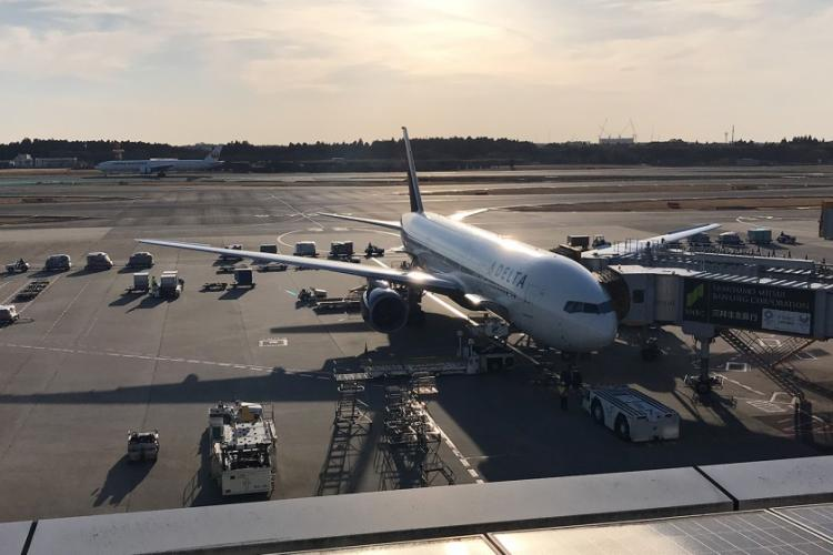 A U.S.-bound plane is parked at a gate at Narita International Airport in Japan, March 9, 2019. AARON KIDD/STARS AND STRIPES