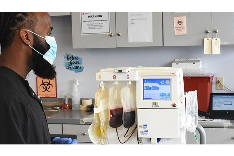 The apheresis process separates whole blood into parts, including yellow plasma as seen in the left bag. Doctors are using COVID-19 convalescent plasma to treat critically ill patients with COVID-19. (Photo by Eric Pilgrim)