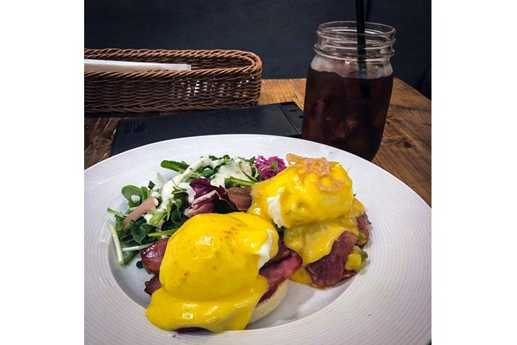 Eggcellent's most popular dish is Half and Half Benedict. One half is a traditional eggs Benedict on an English muffin, while the other is served with quinoa. CHRISTIAN LOPEZ/STARS AND STRIPES
