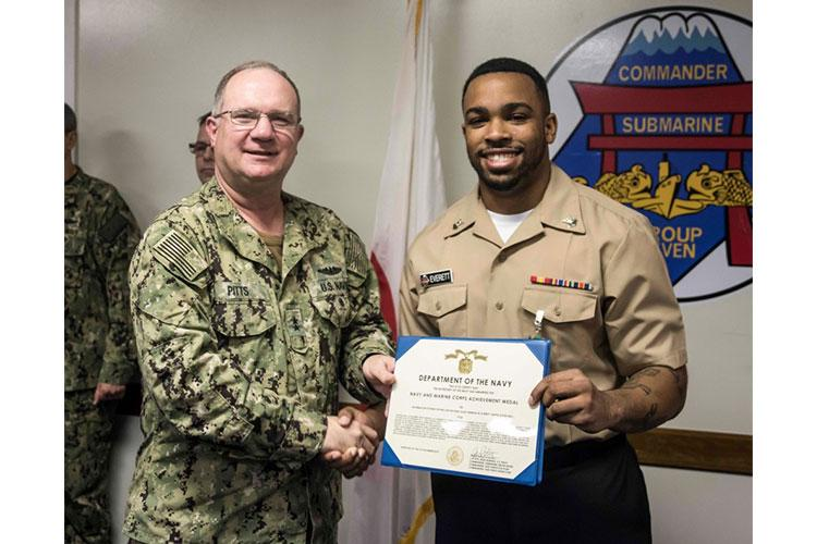 YOKOSUKA, Japan (December 13, 2019) Information Systems Technician 2nd Class Jeremiah Everett, from Upper Marlboro, Maryland, assigned to Submarine Group Seven, receives a Navy and Marine Corps Achievement Medal certificate during an awards ceremony. Everett was recognized as Submarine Group Seven's Bluejacket of the Year. (U.S. Navy photo by Mass Communication Specialist 1st Class Ryan Litzenberger)