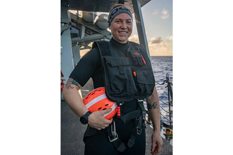PHILIPPINE SEA (March 5, 2021) - Operations Specialist 3rd Class Jenny Fuentes, from Montrose, Colo., poses for a photograph wearing her search and rescue swimmer (SAR) gear. SAR swimmers are vital to the readiness of U.S. Navy ships and serve aboard all units underway.
