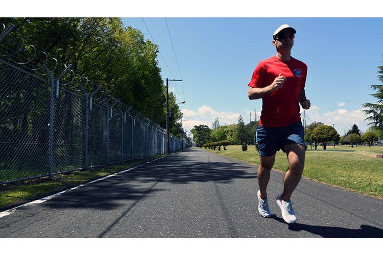 Maj. Craig Gulledge, 374th Wing Safety Office flight safety officer, runs the road near the Yokota Air Base Par Three Golf Course after completing a 100K marathon on that same path a week prior. After an ultra-marathon at the Fuji Five Lakes near Mt. Fuji, Japan was cancelled due to COVID-19, Gulledge optimized his training to run 62 miles at the Yokota Air Base Par Three Golf Course. (U.S. Air Force photo by Staff Sergeant Kyle Johnson)
