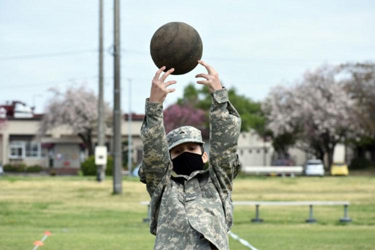 Cadet Cpl. Bryson Gummerus completes the standing power throw portion of the Army Combat Fitness Test during the Zama Middle High School Junior Reserve Officers' Training Corps Cadet Leadership Challenge at Camp Zama, Japan, April 6. (Photo Credit: Photo by Winifred Brown)