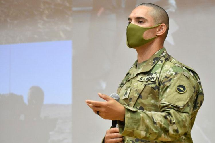 Staff Sgt. James Hankins, individual mobilization augmentee manager for U.S. Army Reserve Affairs Japan, U.S. Army Japan, talks to Japan Ground Self-Defense Force Technical Reserve Candidates about his experiences as an interpreter during the JGSDF Reserve Interpreters Training symposium at Camp Zama, Japan, Sept. 24. Hankins speaks Japanese and English. (Photo Credit: Winifred Brown)