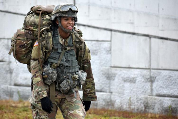 Spc. Brooke Hendricks, assigned to the U.S. Army Japan Band, competes in the 12-mile ruck march during the 2021 U.S. Army Japan Best Warrior Competition at Sagami General Depot, Japan, May 13. Hendricks came in fourth overall with a time of 2 hours, 55 minutes, but was first in the event's Soldier category. She also came in first in the competition's Soldier category. (Photo Credit: Photo by Winifred Brown)