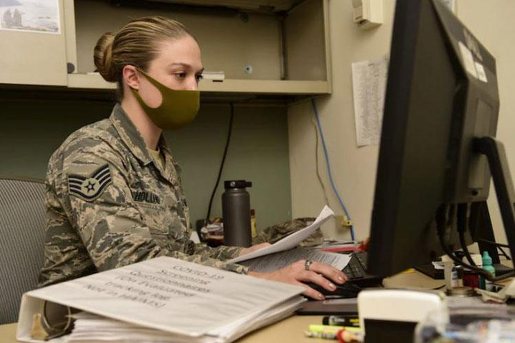 Staff Sgt. Brittany Holland, 374th Operational Readiness Medical Squadron public health technician, scans through patient files at Yokota Air Base, Japan, Nov. 26th, 2020. Public health professionals are responsible for tracking everyone that shows symptoms of COVID-19. (U.S. Air Force photo by Airman 1st Class Tyrone Thomas)
