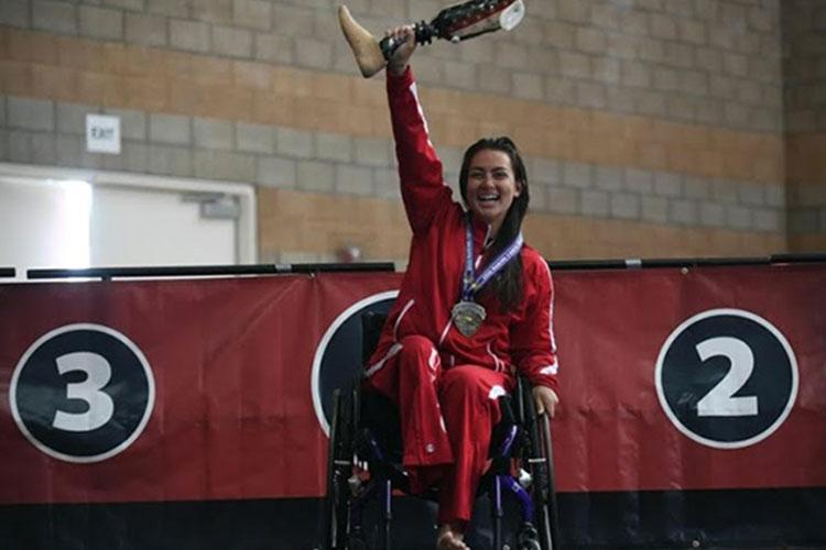 Marine Corps Lance Cpl. Annika Hutsler celebrates winning four gold medals in swimming during the 2020 U.S. Marine Corps Trials in Camp Pendleton, California. (Photo by Roger Wollenberg, DOD.)