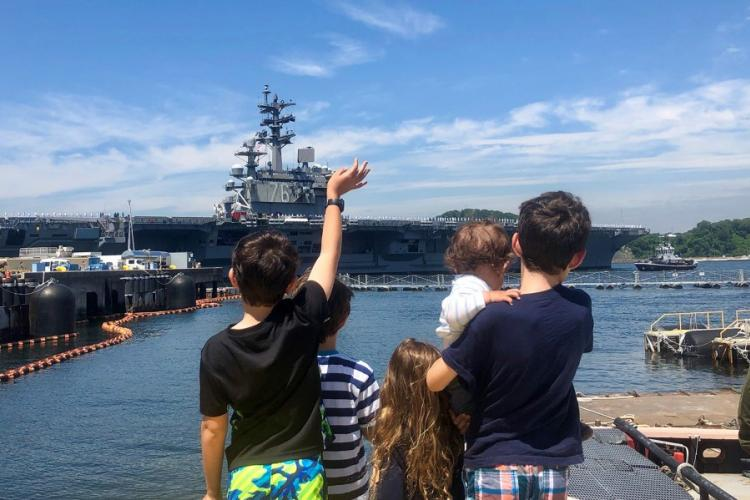 The children of Lt. Cmdr. Daniel Supple – James, 9; Charles, 7; Juliet, 4; Alexander, 1; and William, 12 – watch as the USS Ronald Reagan departs Yokosuka Naval Base, Japan, Wednesday, May 22, 2019. CAITLIN DOORNBOS/STARS AND STRIPES