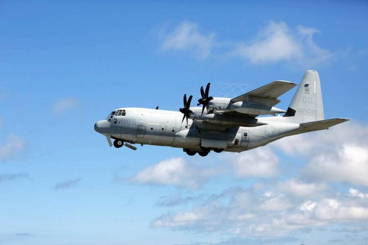 A KC-130J Super Hercules with Marine Aerial Refueler Transport Squadron 152 takes off from Marine Corps Air Station Futenma, Okinawa, July 15, 2014. LUIS RODRIGUEZ/U.S. MARINE CORPS