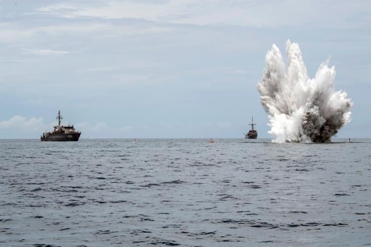 The Royal Thai Navy mine countermeasures ship HTMS Lat Ya, left, and the Avenger-class mine countermeasures ship USS Pioneer observe a controlled mine detonation during Cooperation Afloat Readiness and Training in the Gulf of Thailand, June 7, 2019. CORBIN SHEA/U.S. NAVY