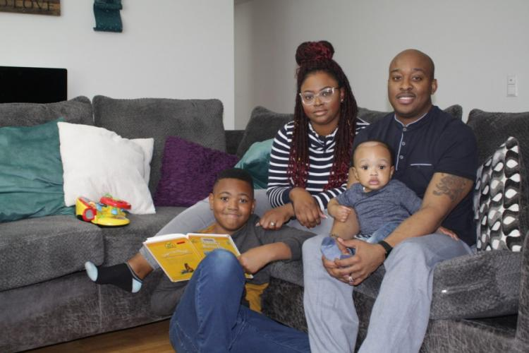 Candace Balfour and Sgt. 1st Class Edward Balfour are pictured with their children in their home at Robinson Barracks in Stuttgart, Germany. Bryson Washington sits on the floor with a book. The Balfours said they were were frustrated and angry at the way the military's school system handled a finding of emotional abuse substantiated by the Family Advocacy Program against Bryson's former teacher. JOHN VANDIVER/STARS AND STRIPES