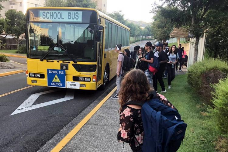 High school students wait for the school bus in the Ikego housing area near Yokosuka Naval Base, Japan, Monday, Aug. 27, 2018. CAITLIN DOORNBOS/STARS AND STRIPES