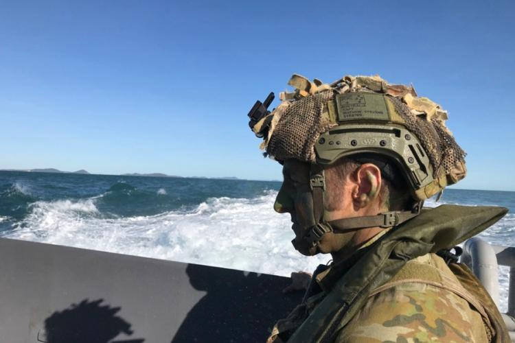 Capt. Matthew Stevens of the Australian army's 7th Infantry Regiment stands aboard a loading transport dock in the Coral Sea as soldiers prepare to practice an amphibious landing and beach assault during Talisman Sabre in Australia, Tuesday, July 16, 2019. CAITLIN DOORNBOS/STARS AND STRIPES