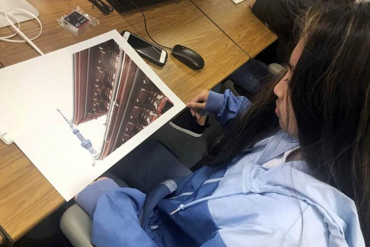 Skylabelle Jimenez, a junior at Nile C. Kinnick High School on Yokosuka Naval Base in Japan, looks over her photograph during the Far East Film and Creative Expressions Festival in Tokyo, May 2, 2019. DAVE ORNAUER/STARS AND STRIPES