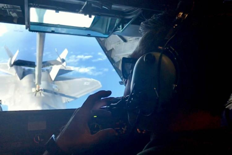 Air Force Tech. Sgt. Dave Pingleton, a boom operator, refuels an F-22 Raptor from a KC-10 Extender during a Talisman Sabre drill over the Coral Sea, Friday, July 19, 2019. CAITLIN DOORNBOS/STARS AND STRIPES