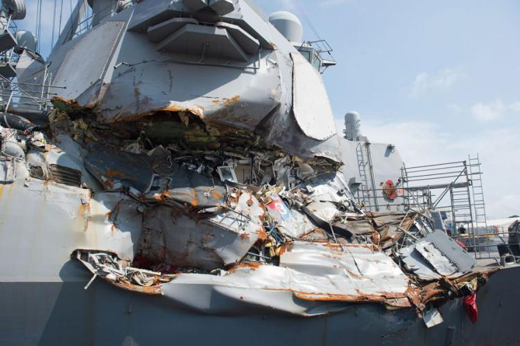 In a July 13, 2017, photo, the USS Fitzgerald sits in Dry Dock 4 at Fleet Activities Yokosuka, Japan, to continue repairs and assess damage sustained from its collision with a merchant vessel. CHRISTIAN SENYK/U.S. NAVY