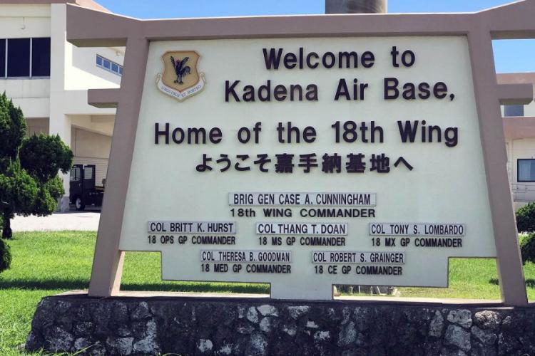 A sign near the Kadena Air Base flight line welcomes arrivals to the home of the 18th Wing in Okinawa, Japan, Sept. 17, 2018. AARON KIDD/STARS AND STRIPES