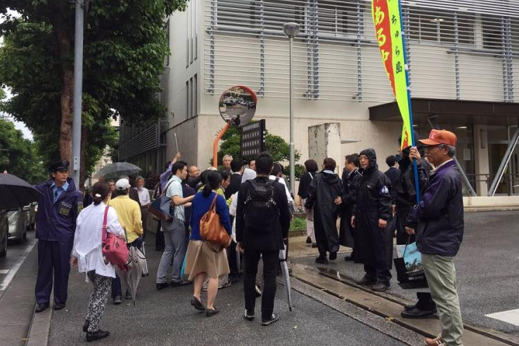 Okinawa residents who had sued over aircraft noise from Marine Corps Air Station Futenma walk toward Fukuoka High Court Naha Branch, Tuesday, April 16, 2019. AYA ICHIHASHI/STARS AND STRIPES