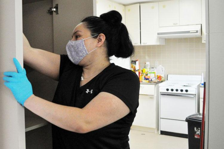Jo Messerle, owner of DustBusters cleaning service, cleans the home of a moving Soldier on Camp Zama, Japan, Oct. 27. (Photo Credit: Winifred Brown)
