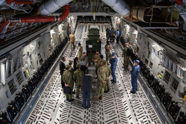U.S. Military, Japan Self-Defense Force leadership and other service members discuss mission operations on a C-17 Globemaster III, assigned to the 535th Airlift Squadron out of Hickam Air Force Base, Hawaii, during Keen Sword 21, at Yokota Air Base, Japan, Oct. 31, 2020. Keen Sword is a training opportunity between JSDF and the U.S. military across a variety of scenarios, allowing the enhancement of interoperability of U.S. and Japanese forces. (U.S. Air Force Photo by Staff Sgt. Gabrielle Spalding)