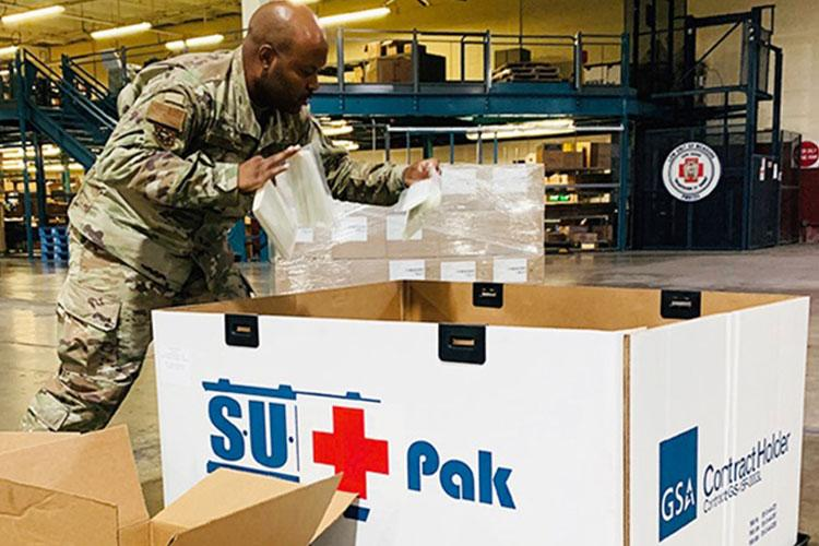 Air Force Tech. Sgt. Brison King, non-commissioned officer in charge, Warehouse Operations, Joint Base San Antonio, Texas, packs critical lab supplies at Port San Antonio, Texas, August 24, 2020. (Courtesy Photo)