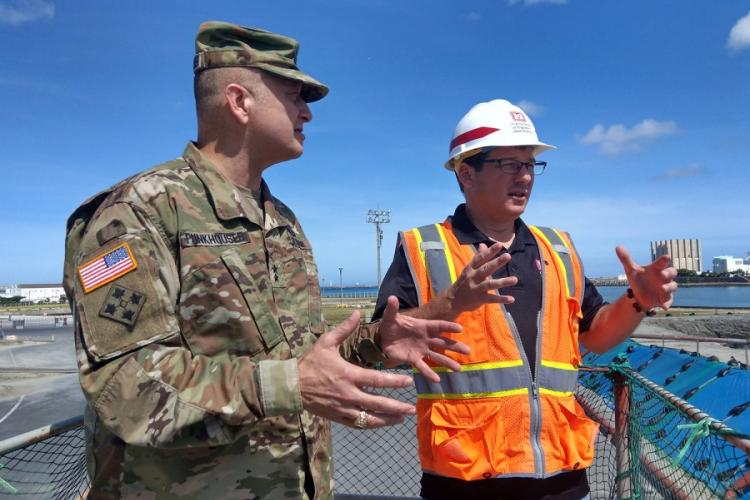 Maj. Gen. Anthony Funkhouser, left, U.S. Army Corps of Engineers deputy commander, checks out construction of a military port in Naha, Japan, in this undated photo. U.S. ARMY CORPS OF ENGINEERS
