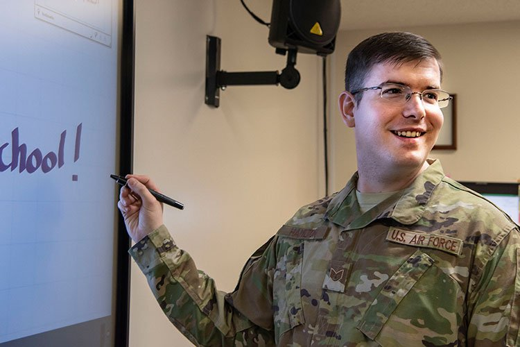 U.S. Air Force Staff Sgt. Jonathan Hamilton, a 35th Force Support Squadron instructor, returns to previous notes using a SMART Board purchased with squadron innovation funds during an Airman Leadership School class at Misawa Air Base, Japan, Jan. 25, 2019. The SMART Boards replaced overhead projectors and whiteboards, allowing students to access digital notes from previous classes and better retain the course material. (U.S. Air Force photo by Airman 1st Class Xiomara M. Martinez)