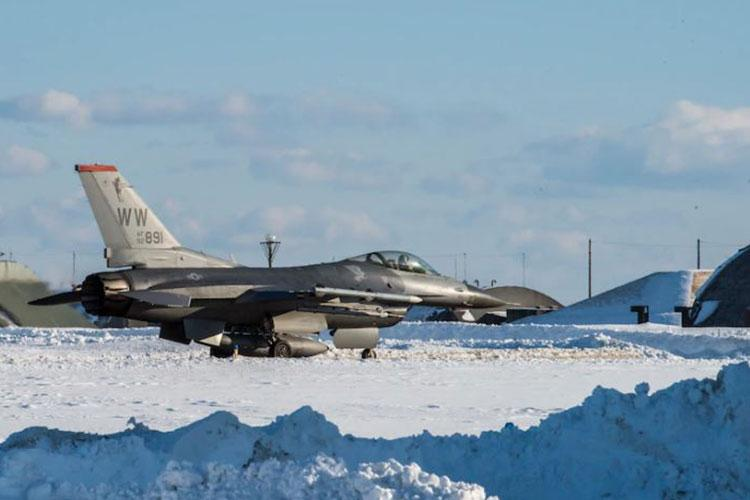 A U.S. Air Force F-16 Fighting Falcon, assigned to the 13th Fighter Squadron, taxis towards the runway at Misawa Air Base, Japan, Jan. 11, 2021. Despite the harsh weather conditions, the 35th Fighter Wing continues executing its mission of projecting combat air power and defending. (U.S. Air Force photo by Airman 1st Class Leon Redfern)