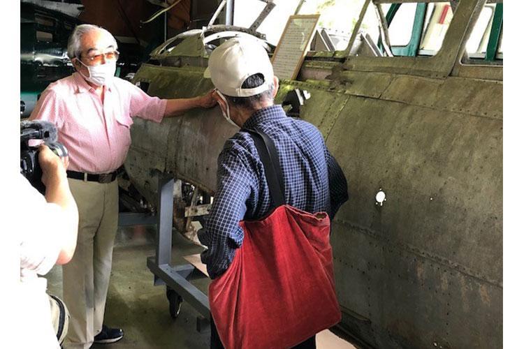 Mr. Nobuo Harada explaining his MYRT restoration plans to media representative on Press Day at his Kawaguchiko Aviation Museum on Saturday, July 31, 2021 (photo by Michael Ryan)